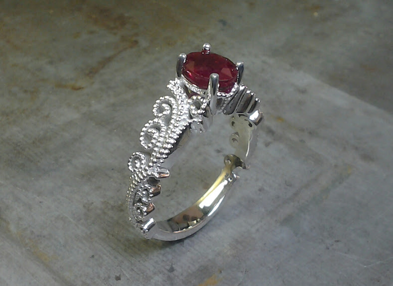 mill-grain style engagement ring
