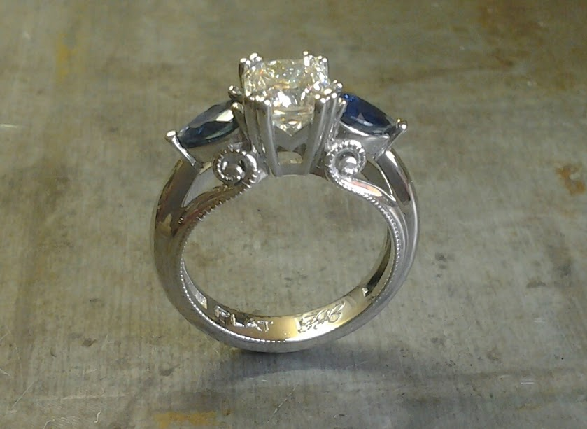 Art deco inspired scroll round diamond and pear shaped sapphire