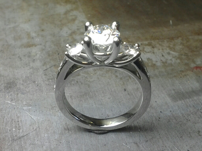 3 stone w prong engagement ring