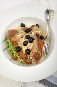 mediterranean chicken drumsticks tomato sauce on spaghetti