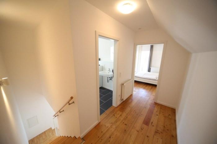 Oberes Stockwerk mit Holzdielenboden im Ferienhaus Hofhaus