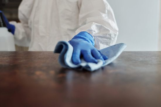 close up photo of person cleaning the table