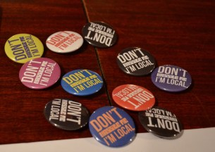 """""""Don't hassle me. I'm local"""" pins."""