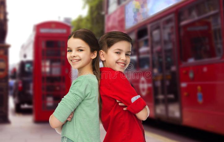 happy-boy-girl-standing-over-london-city-childhood-travel-tourism-people-concept-smiling-back-to-back-street-background-68435679