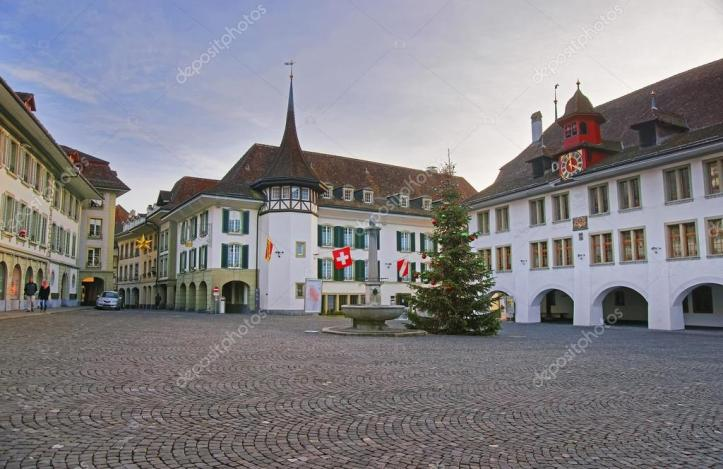 depositphotos_98190360-stock-photo-town-hall-square-with-christmas