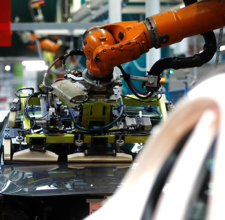 A-robot-engineered-by-Kuka-adjusts-a-windscreen-in-a-fully-automated-process-on