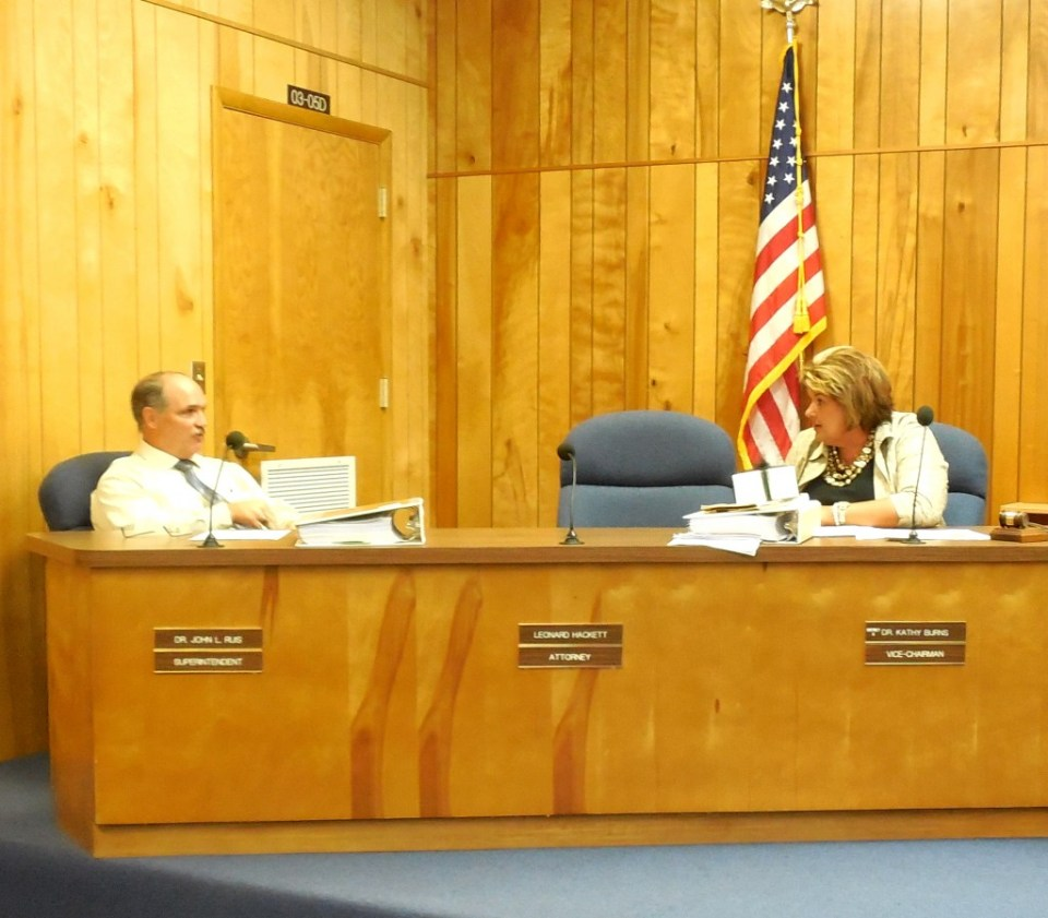 Superintendent John Ruis and then School Board Vice Chair Kathy Burns (District 5) during a School Board meeting