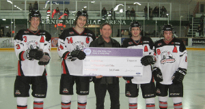 Photo Dylan Robertson, Ben Primeau, Aaron Neufeld and Austin Hirano are handed a $4800 check by Fernie Ford's Dave Thompson
