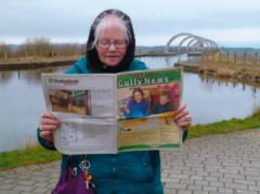 Mrs Quinn, reading beside the Falkirk Wheel, Scotland.