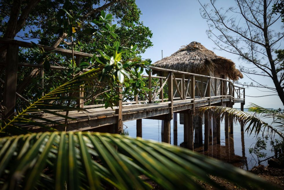 Overwater bungalow over the ocean on Thatch Caye island in Belize