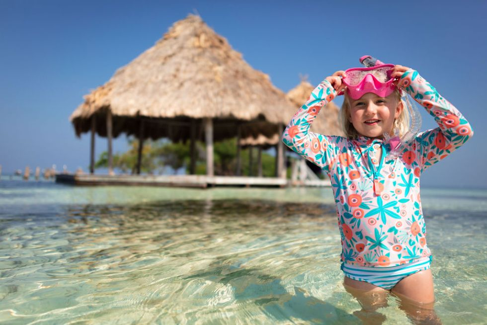 Girl learning how to snorkel on Thatch Caye island in Belize