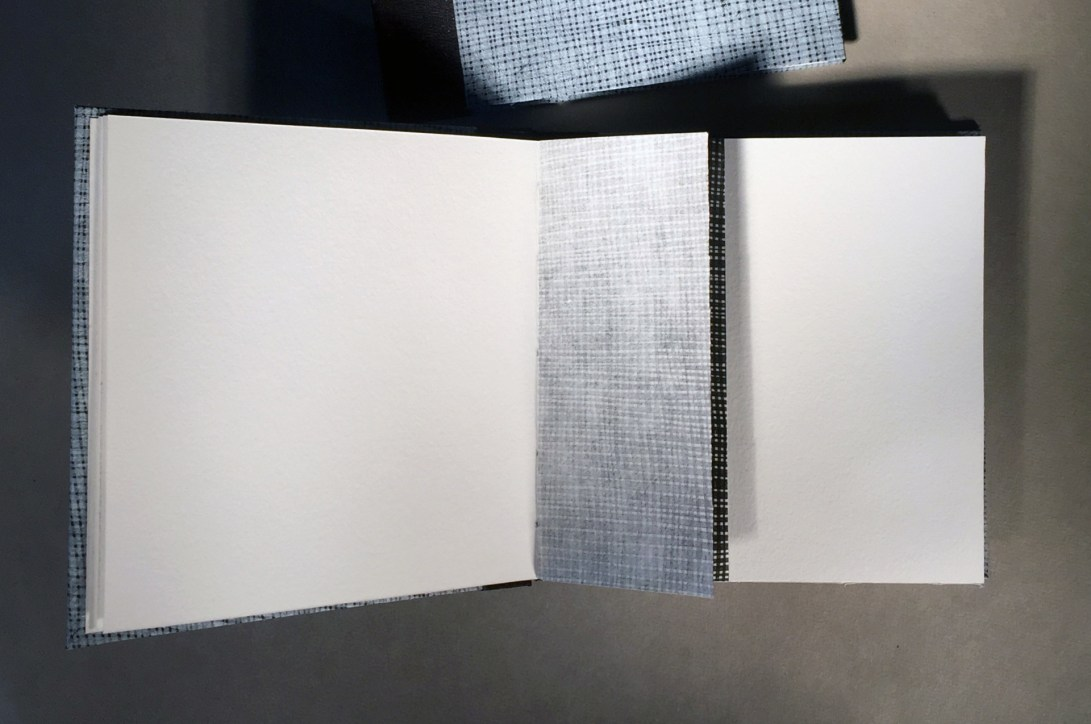 """Interior half page of an artist book titled """"1 over 1"""", with image of netting on reverse side"""