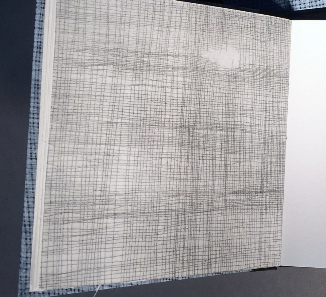 """Close-up view of interior page of an artist book titled """"1 over 1"""", artwork that looks like a screen or netting"""