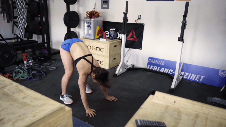 Camille Leblanc-Bazinet demonstrates the second step of a four-count burpee.