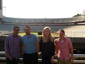 group in front of stadium