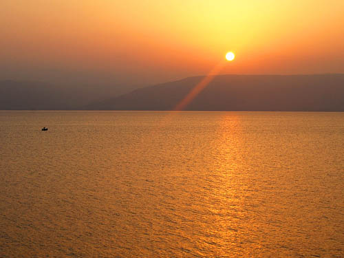 A lone fisherman on the Sea of Galilee at sunrise. Photo by Ferrell Jenkins.