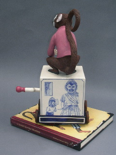 "Red Weldon Sandlin, ""The Hurtea Gurdy Tales: A Nickel for the Monkey"" 2006, reverse, ceramic, wood, acrylic paint, 16.5 x 11.5 x 11""."