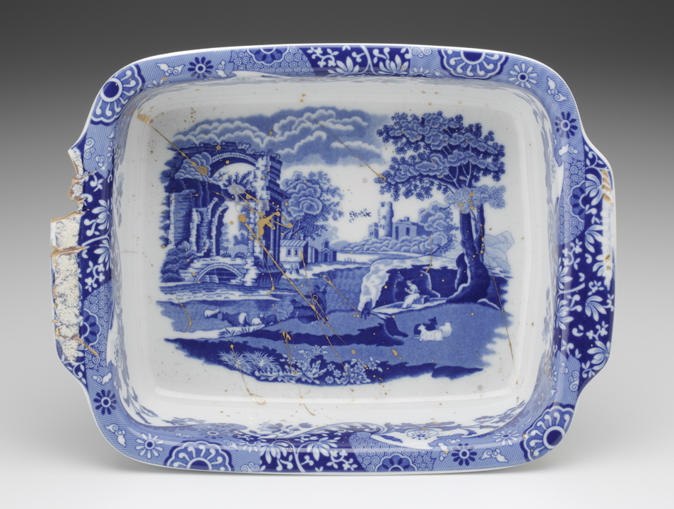"""Paul Scott, """"Cumbrian Blue(s) - Spode Works Closed, Italian Blue, 03/10/09/09l,"""" 2013, in-glaze decal, gold lustre on small Spode casserole, (marked Made in Portugal) salvaged from the kiln area in the closed Spode factory 07/09, 3.5 x 9 x 11.25"""". Rhode Island School of Design Collection."""
