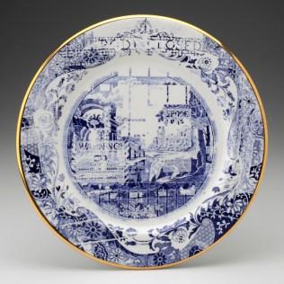 "Paul Scott, ""Cumbrian Blue(s) – Spode Works Closed, Shops"" 2011, in-glaze decal, gold lustre on salvaged Spode bone china, 12"" diameter."