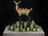 """Jason Walker, """"Redtail"""" 2014, porcelain, stoneware, underglaze, china paint and concrete, 32 x 64 x 52""""."""