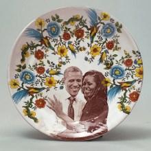 "Justin Rothshank, ""Barak and Michelle Obama Salad Plate"" 2017, earthenware, glaze, ceramic decals, 1.25 x 9""."