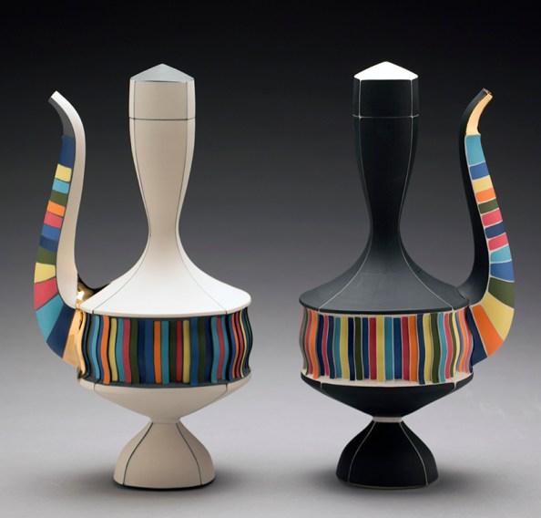 "Peter Pincus, ""Ewer"" (white), 2016, colored porcelain, colored slip, gold lustre, 12 x 6 x 5"". Peter Pincus, ""Ewer"" (black), 2016, colored porcelain, colored slip, gold lustre, 12 x 6 x 5""."