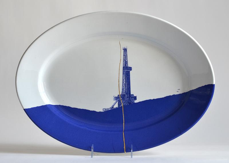 "Paul Scott, ""Scott's Cumbrian Blue(s), Fracked No: 7,"" 2015, glaze, decal, gold, c. 1850 Richard Alcock ironstone platter, 11.5 x 14.5 x 2"". Carnegie Museum of Art Collection."