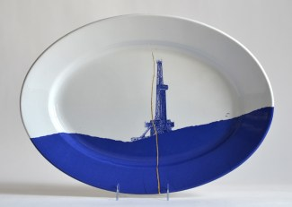 "Paul Scott, ""Scott's Cumbrian Blue(s), Fracked No: 7,"" 2015, glaze, decal, gold, c. 1850 Richard Alcock ironstone platter, 11.5 x 14.5 x 2"". Carnegie Museum of Art Collection."