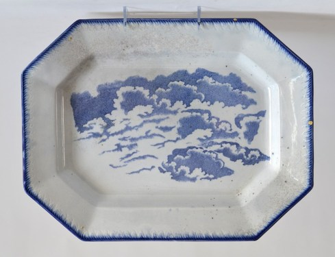 "Paul Scott, ""Scott's Cumbrian Blue(s), Clouds after Cadre and Lisa,"" 2015, glaze, decal, gold, c. 1840 feather-edge pearlware platter, 11.25 x 14.75 x 1.25""."