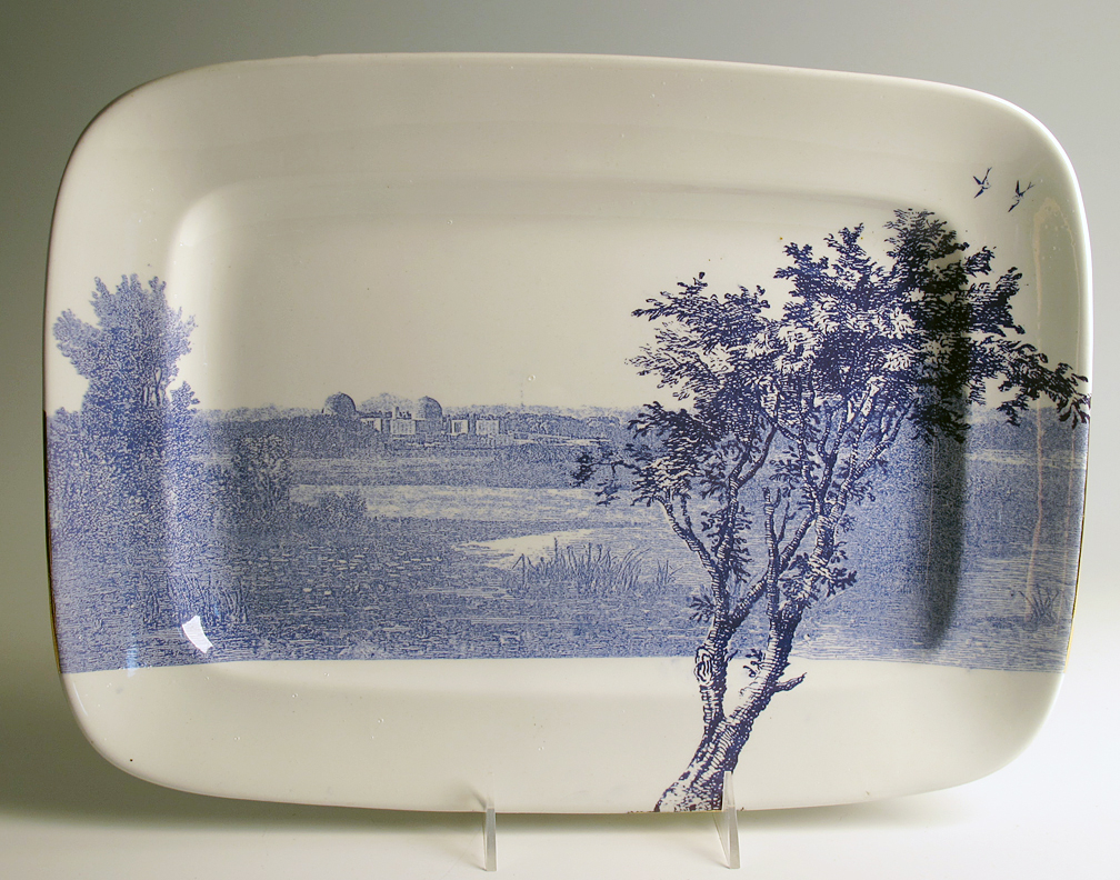 """Paul Scott, """"Cumbrian Blue(s), American Scenery, Hudson River, Indian Point No. 2"""" 2013, inglaze decal collage, gold luster on KT&K S--V China (Knowles Taylor and Knowles, Liverpool, Ohio) platter, c. 1920, 7 x 10""""."""
