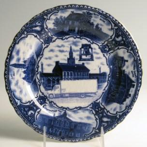 "Paul Scott, ""Cumbrian Blue(s), American Scenery, Souvenir of Philadelphia"" 2013, Inglaze decal collage, gold luster on Souvenir plate England unknown manufacture c. 1900, 8.5 x 1""."