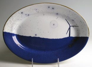 "Paul Scott, ""Cumbrian Blue(s), American Scenery, Windturbine No. 1"" 2013, Inglaze decal collage, gold luster on Johnson Bros Late Pankurst Co., Ironstone platter c. 1890, 8.75 x 12 x 1""."