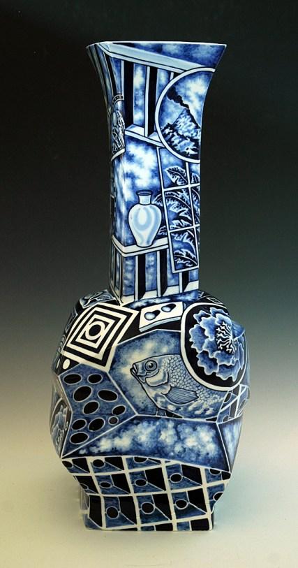 "Kurt Weiser, ""Pair of Cubist Vases (1)"" 2013, porcelain, cobalt pigment, glaze, 23.5 x 12 x 10""."