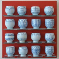 """Steven Young Lee, """"Blue Cups on Red"""" 2013, porcelain with cobalt inlay."""