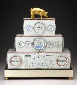 "Mara Superior, ""Piggy Bankers/The Great Recession of 2008"" 2009, porcelain, wood, white gold leaf, gold leaf, bone, brass balls, 24 x 23 x 9.5""."