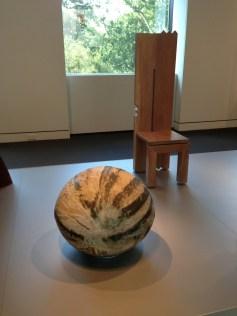 Front - Toshiko Takaezu,3/4 Moon, 1985, Glazed Stoneware, Gift of Mary Louise Myers Wendy Maruyama, Post Nuclear Primitive Chair, 1986, Gift of Duncan W. Cowdy MFA Boston