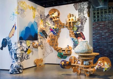 "Mark Cooper, ""YuYu Kansas"" 2013, installation using ceramic, wood, fiberglass, digital photography, rice paper, size variable."