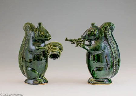 "Michelle Erickson, ""Green Squirrel"" (left), ""Second Amendment Squirrel"" (right), 2013, indigenous clay, glaze, 8""."