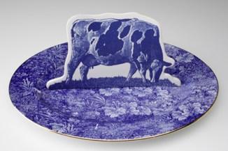 "Paul Scott, ""Cumbrian Blue(s): Crooklands Cow in a Meadow"" 2007/2013, earthenware, tin glaze, bone china platter, inglaze decals, gold lustre, 15.75""."