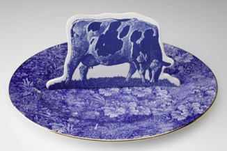 "Paul Scott, ""Cumbrian Blue(s): Crooklands Cow in a Meadow"" 2007/2013, earthenware, tin glaze, bone china platter, inglaze decals, gold lustre, 15.75""."
