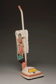 "Shalene Valenzuela, ""Easy Vac: Always in Fashion"" 2011, porcelain, underglaze, print transfer, 42 x 11x 14""."