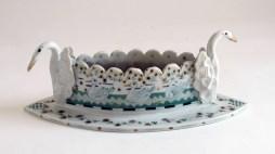 """Mara Superior, """"Swan Vase"""" 2000, porcelain, 4.5 x 13.5""""."""