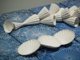 "Giselle Hicks, ""Pattern Language"" (detail), 2010, porcelain, terra sigillata, wood, graphite, 36 x 24 x 114""."