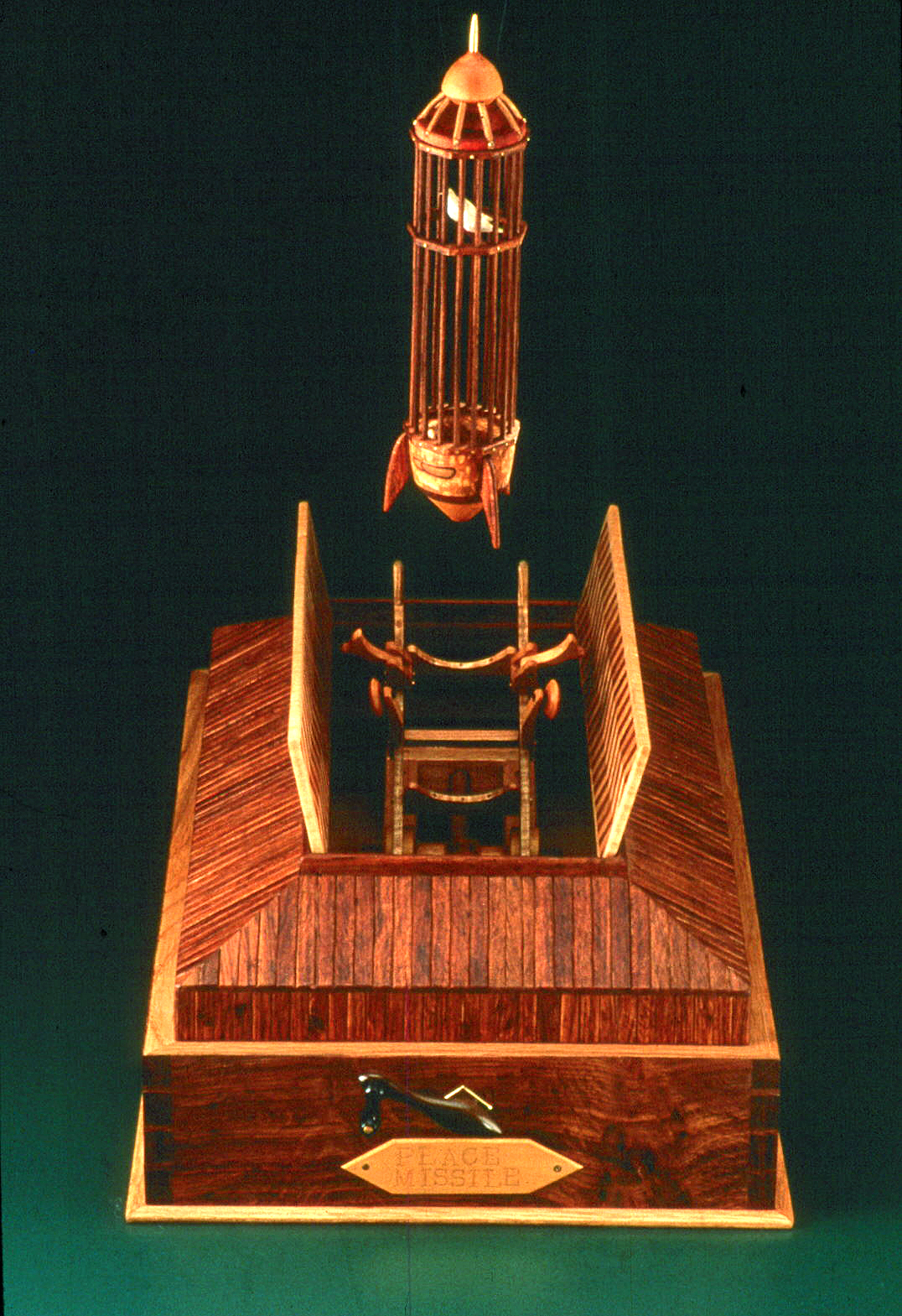 """Roy Superior, """"Peace Missile"""" 1985, wood, brass, music box, 20 x 7 12"""". (Collection of the Artist)"""