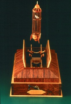"Roy Superior, ""Peace Missile"" 1985, wood, brass, music box, 20 x 7 12"". (Collection of the Artist)"