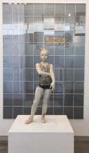 """Cristina Córdova, """"Alegoria criolla"""" 2016, ceramic, resin, metal, 48 x 18 x 16"""". Jack Delano, """"Malaria poster in small hotel, Puerto Rico"""" 1941, paper, glass, plastic, wood, 90 x 64""""."""