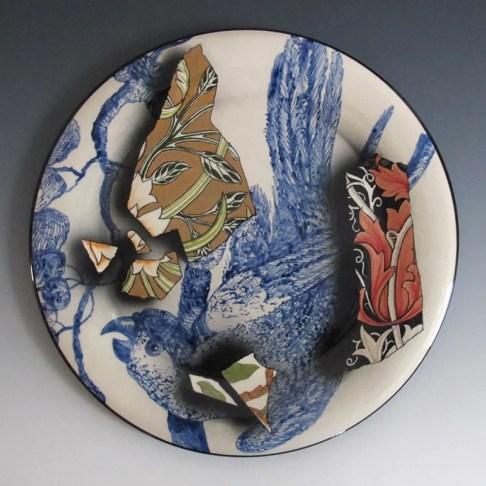"Stephen Bowers, ""Camouflage Plate"" 2016, earthenware, under glaze colour, clear earthenware glaze, on-glaze burnished gold lustre, enamel, 12.25 x 1""."