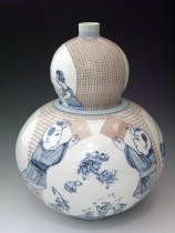 "Sin-ying Ho, ""Future is in our Hand"" 2008, porcelain, cobalt, decal, terra sigillata, 15 x 10""."