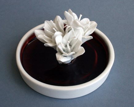"Julie Bartholomew, ""Rarely Seen, Darvinia Carnea with Instect"" 2013, porcelain, copper red glaze, decals, 2.4 x 3.5""."