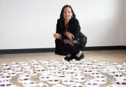 """Julie Bartholomew with installation of """"Rarely Seen."""""""